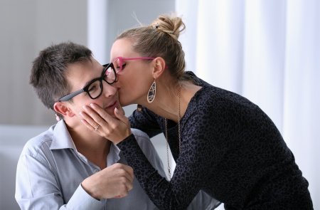 young couple kissing: happy young couple kissing in the office