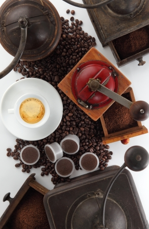 composition of grinders for coffee with cup and beans and capsules Stock Photo - 21687682