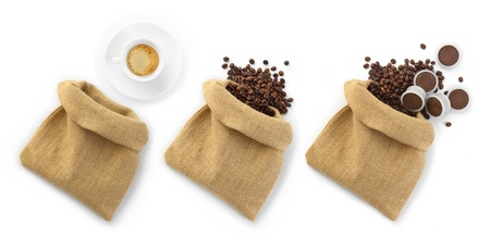 jute bags of coffee beans with a cup of coffee and capsules photo