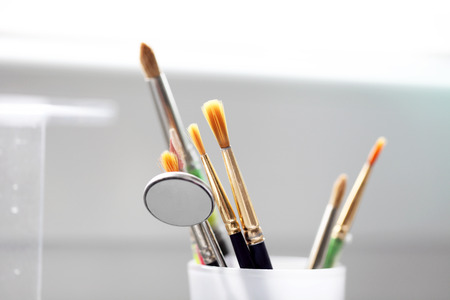 various brush tools in dental clinic photo