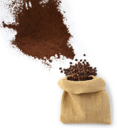beans and coffee powder with jute bag as seen from above Reklamní fotografie