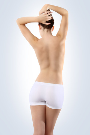 Body of woman ass and back on white background photo
