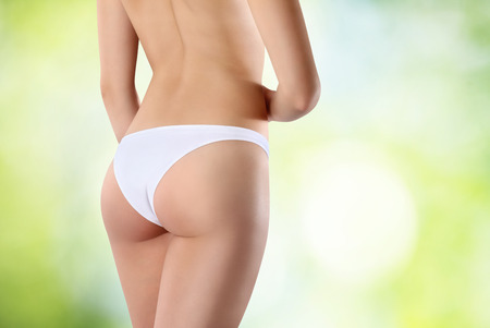 Beautiful body of woman exposing bottom and back side, Isolated on green background photo