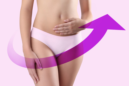 woman panties: woman hands on belly with violet arrow in pink background