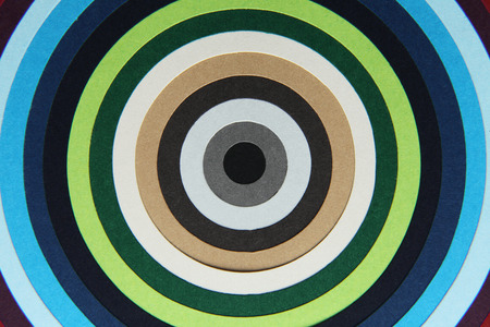 hypnotize: background texture of colored paper into circles