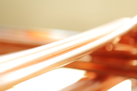 hard alloy: background of copper pipes Stock Photo