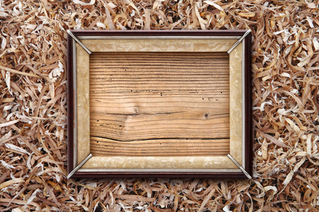 wood shavings: Old frame on a wooden background