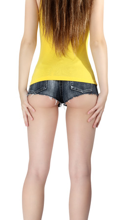 short back: ass woman wearing a short jeans shorts with yellow tank top Stock Photo