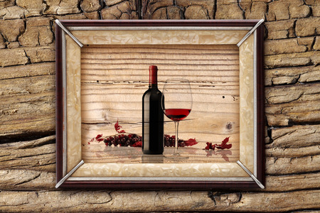 bottle and glass of wine on wooden backgrounds photo