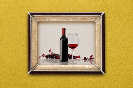 bottle and glass of wine in the frame on the wall photo