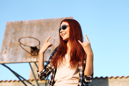round face: girl showing symbol of rock music Stock Photo