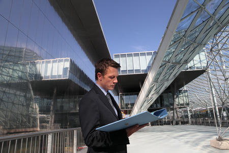 structural: engineer business man reading a folder, calculations and construction of architecture Stock Photo