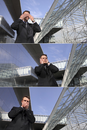cowardice: business man see no evil, hear no evil, speak no evil, three monkeys concept Stock Photo