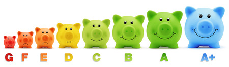 piggy bank scale class energy savings Stock Photo