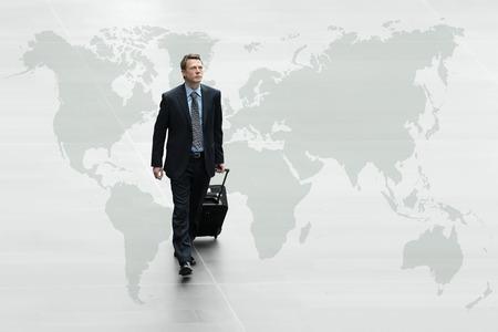business man walking on the world map, international travel concept photo