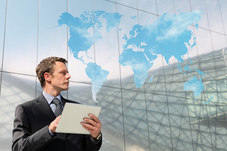 clouding: business man with tablet world map clouding computing global communication concept