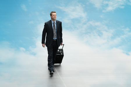 business man travel on the sky background clouding computing concept photo