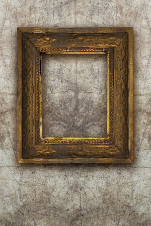 gold picture frame: old picture frame handmade wood on wall ruined background