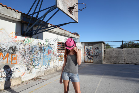 murals: Teen with hat in the playground with graffiti Stock Photo