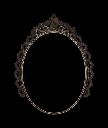 ged: old oval picture frame metal worked on black background