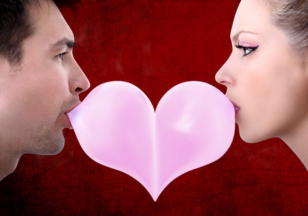 gum: lovers couple kiss heart shaped valentine day with chewing gum