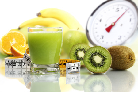 weight control: kiwi juice in glass, fruit meter scales diet food