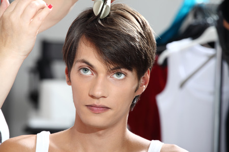 beauty center: hairdresser to work with man in the mirror Stock Photo