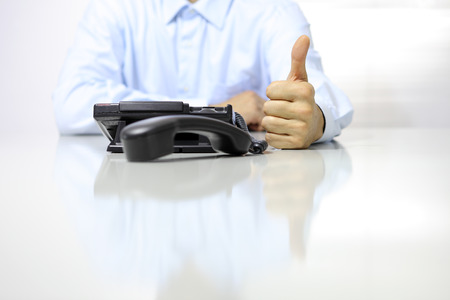 office desk: like hand with office phone on desk