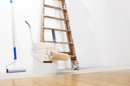 cleaning background: painter wall concept, ladder, bucket, roll paint on the floor