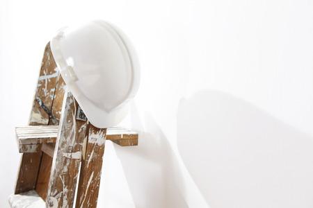 painter wooden ladder with helmet worker, leaning wall Reklamní fotografie