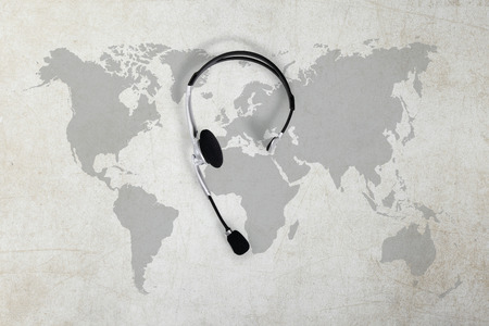 contact global concept , top view headset and map Reklamní fotografie