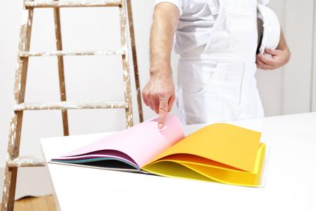 painter man choose color from samples Reklamní fotografie - 44894513