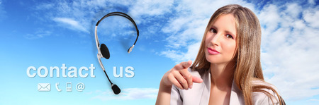 contact center: call center operator with headset and contact us text Stock Photo