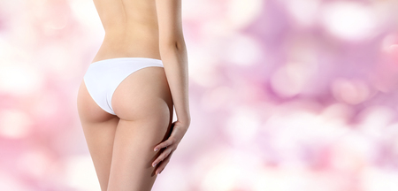 girl legs: Beautiful body of woman exposing bottom and back side, Isolated on pink background Stock Photo