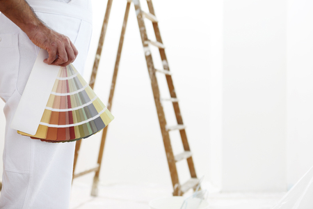 painter and decorator: painter man with color swatches in your hand Stock Photo