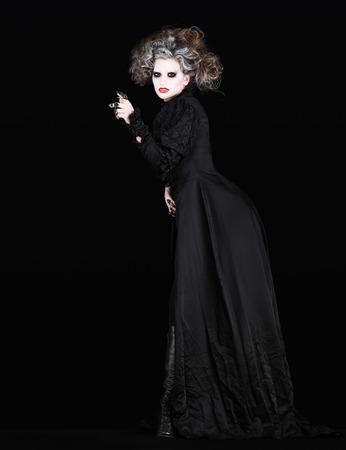 indignant: vampire woman with black gothic costume halloween concept