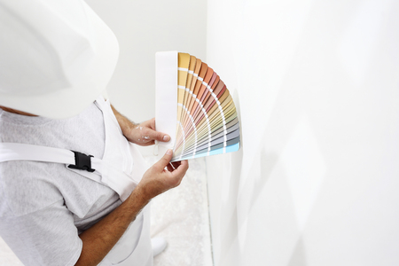 paint swatch: painter man with color swatches in your hand Stock Photo