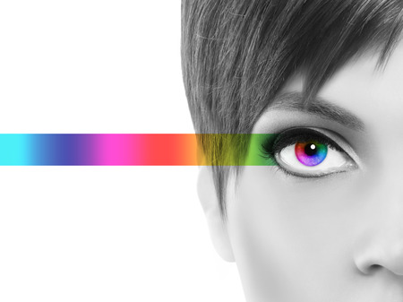 correction: oculistic concept, black and white portrait half woman, eyes colorful rainbow