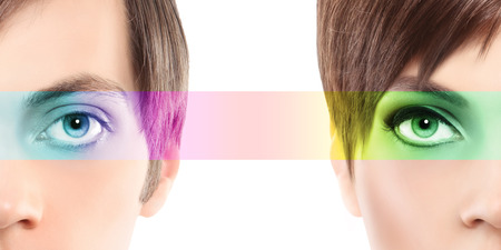 correction: oculistic concept, portrait half woman half man, eyes colorful rainbow Stock Photo