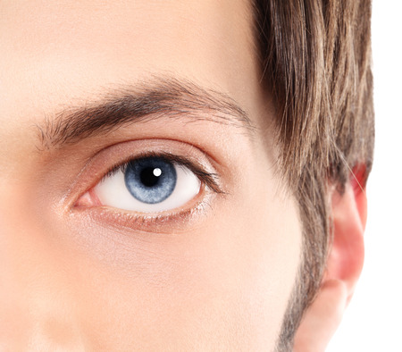 Half face Closeup of blue eyes from a young man