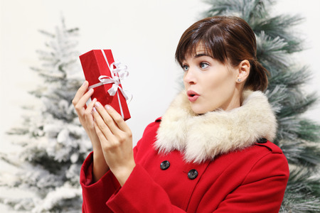 woman surprise: woman with Christmas gift present, surprise