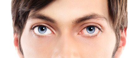 blue vessels: Closeup of blue eyes from a young man red and irritated eye with blood vessels