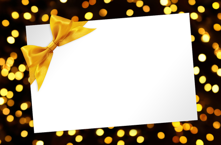 golden background: blank Card with bow in golden lights background