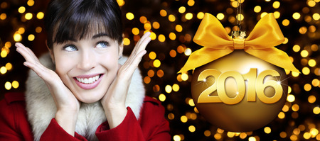 stupor: happy new year 2016, woman looks up on lights background