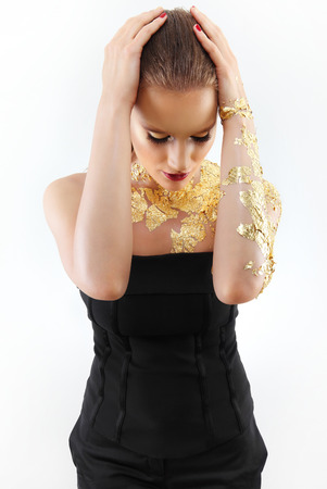 gilded: glamour fashion makeup model, gilded body paint Stock Photo