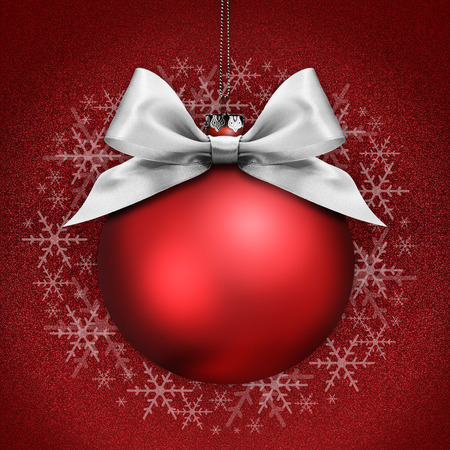 argent: christmas ball with silver satin ribbon bow on red background Stock Photo