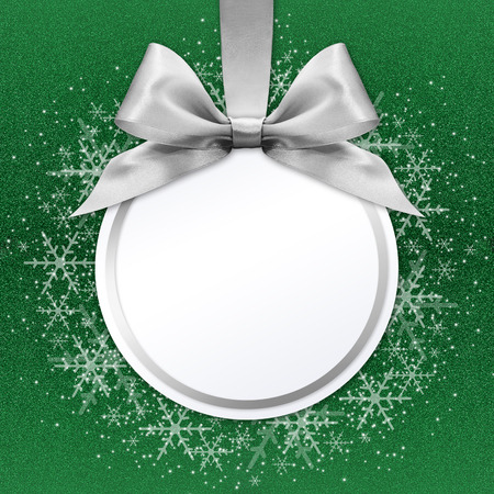 silver backgrounds: christmas ball with silver satin ribbon bow on green background