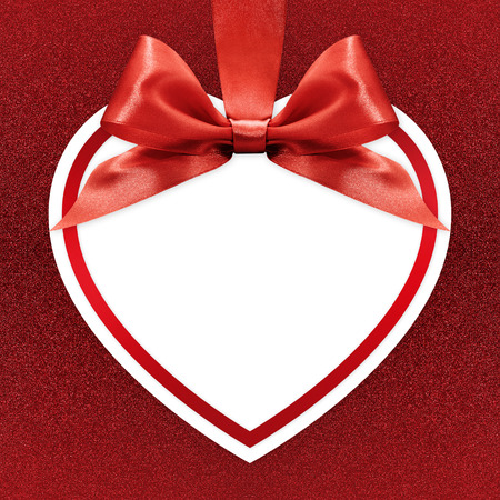 heart design: white heart with ribbon bow on red background Stock Photo