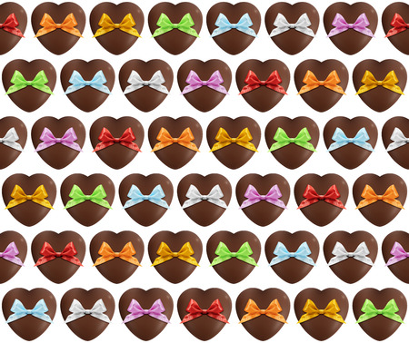 sundry: hearts chocolate pattern with colored bow on white background Stock Photo