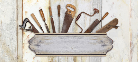 signboard and carpenter tools on wooden background